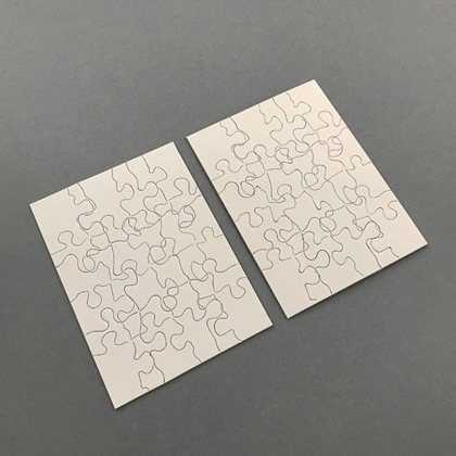 Two Puzzles: the image of one puzzle printed on another and vice versa by Micah Lexier